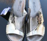 Florance Leather Gold flat mule sandal.