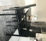 Black dining table and 4 black chairs