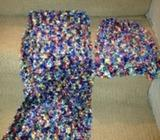 Hand knitted scarf and knitted hat